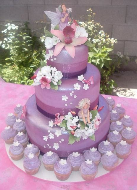 Three tier lavender cake with matching cupcakes